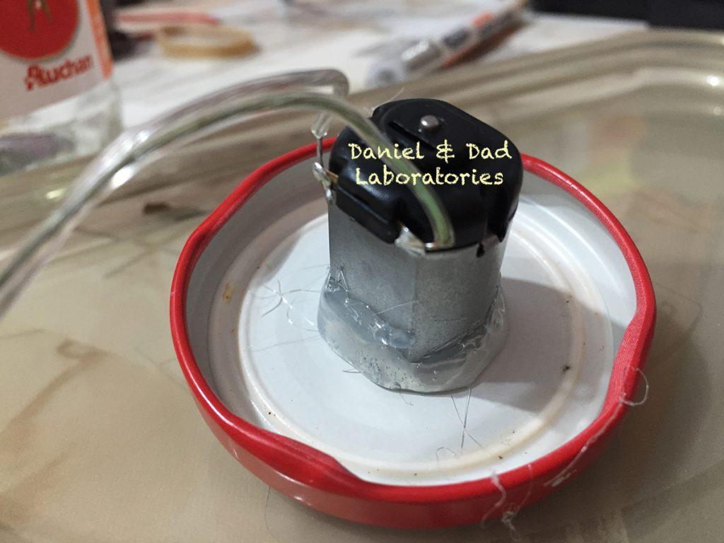 glue motor on bootle lid